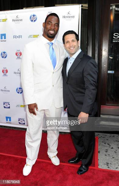 NFL player Justin Tuck and TV personality Adam Schefter attend NY Giants Justin Tuck's 3rd Annual Celebrity Billiards Tournament at Slate on June 2...
