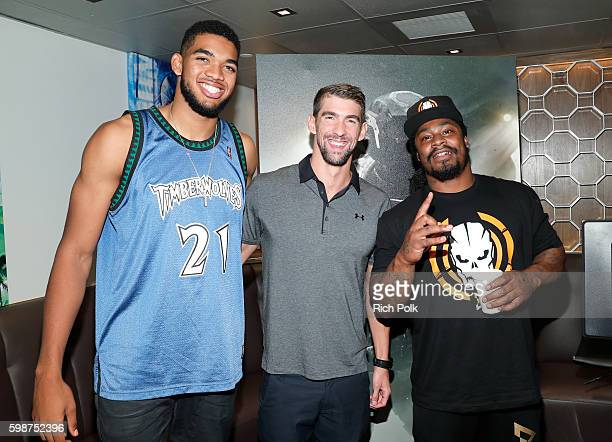 NBA player KarlAnthony Towns Olympic swimmer Michael Phelps and NFL player Marshawn Lynch attend The Ultimate Fan Experience Call Of Duty XP 2016...
