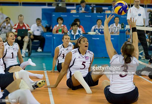 US player Katie Holloway watches teammate Brenda Maymon serve the ball against Latvia The US easily won in three sets