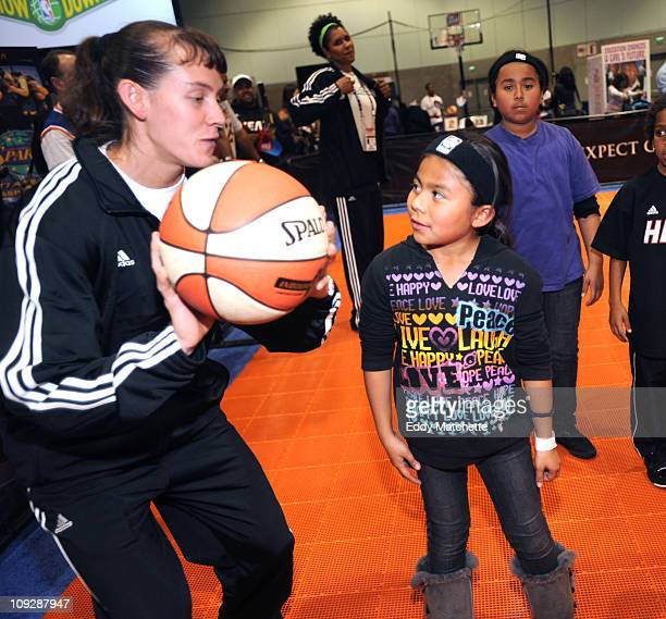 WNBA player Kelly Miller gives some shooting tips to eight year old Precious Romero of Burbank California at the NBA Jam Session sponsored by Adidas...