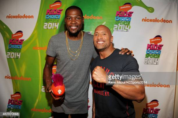 NBA player Kevin Durant and actor Dwayne 'The Rock' Johnson attend Nickelodeon Kids' Choice Sports Awards 2014 at UCLA's Pauley Pavilion on July 17...