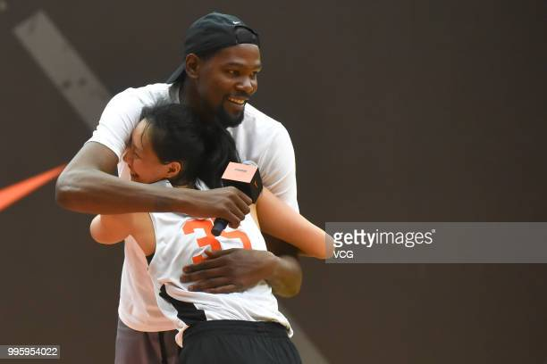 NBA player Kevin Durant of Golden State Warriors hugs a little player at the NIKE Rise Academy activity during his trip to China on July 7 2018 in...