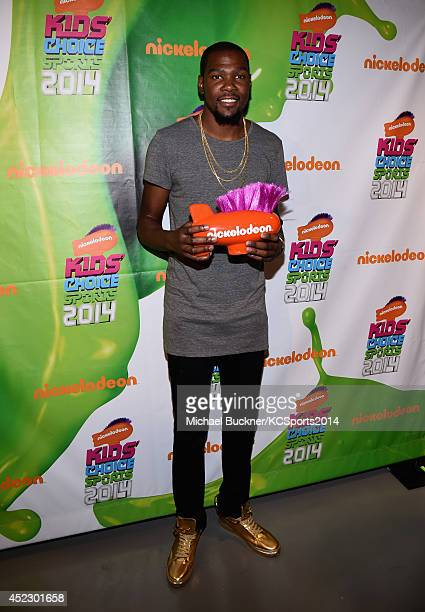 NBA player Kevin Durant wins best male athlete at the Nickelodeon Kids' Choice Sports Awards 2014 at UCLA's Pauley Pavilion on July 17 2014 in Los...