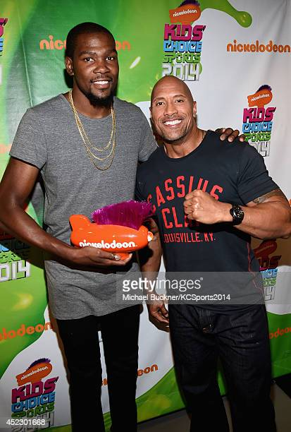 NBA player Kevin Durant with actor Dwayne Johnson backstage with award for Best Male Athlete at the Nickelodeon Kids' Choice Sports Awards 2014 at...