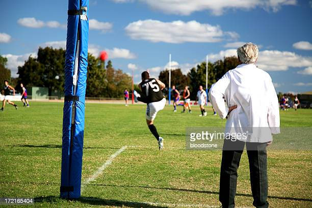 a player kicking the ball during practice in the field - afl stock pictures, royalty-free photos & images