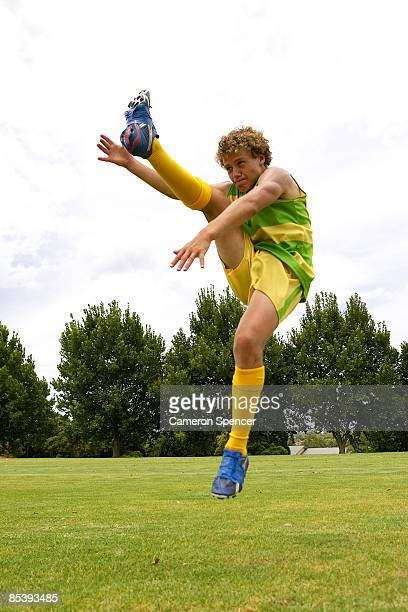 player kicks australian football - afl stock pictures, royalty-free photos & images