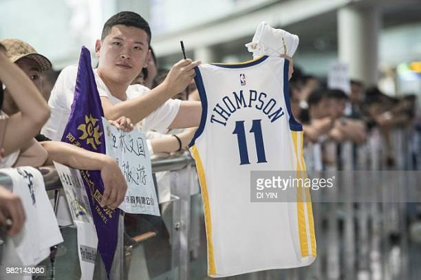 NBA player Klay Thompson of the Golden State Warriors is welcomed by fans at Beijing Capital International Airport on June 24 2018 in Beijing China