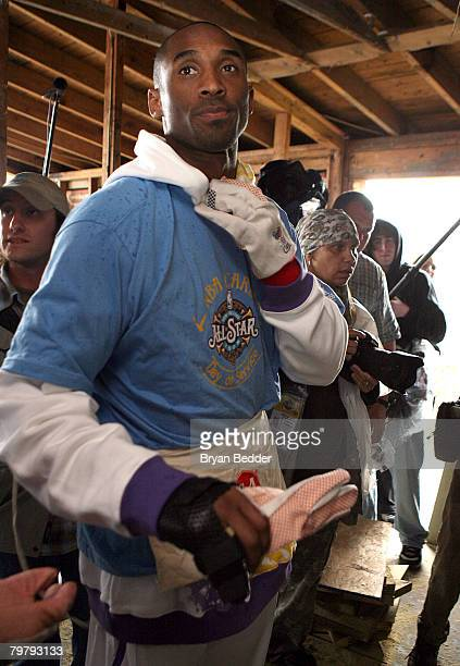 NBA player Kobe Bryant of the Los Angeles Lakers helps build a home with NBA Cares during NBA AllStar Weekend on February 15 2008 in New Orleans...