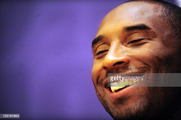 NBA player Kobe Bryant of the Los Angeles Lakers smiles during a meet and greet with fans at Jinan University on July 29 2010 in Guangzhou Guangdong...