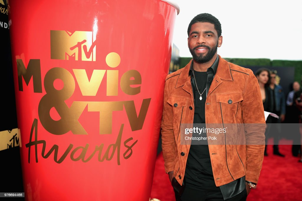 NBA player Kyrie Irving attends the 2018 MTV Movie And TV Awards at Barker Hangar on June 16, 2018 in Santa Monica, California.