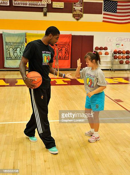 Player Kyrie Irving attends the basketball clinic hosted by Cleveland Cavaliers player Kyrie Irving to kick off the 2013 Audi Best Buddies Challenge...