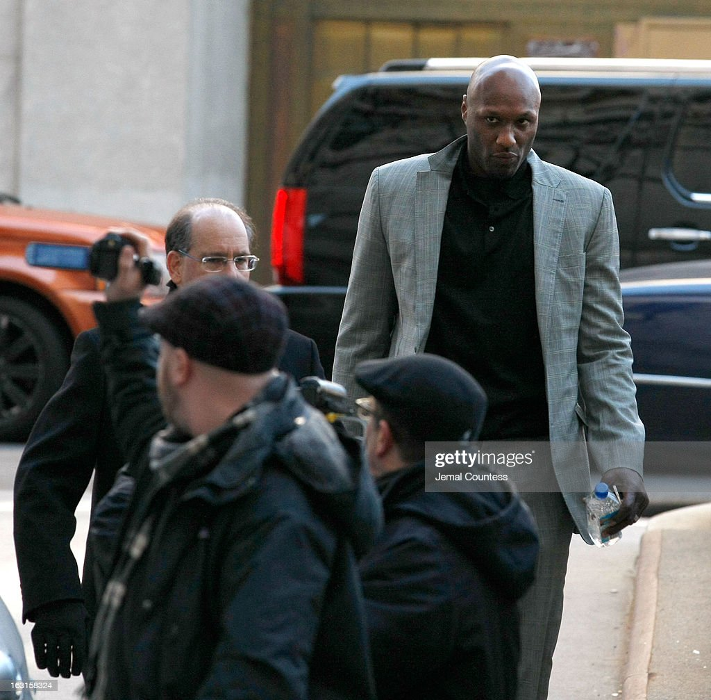 NBA player Lamar Odom arrives to attend a custody hearing with ex-girlfriend Liza Morales at New York State Supreme Court on March 5, 2013 in New York City. Morales is the mother of Lamar's nine-year old daughter and five-year old son.