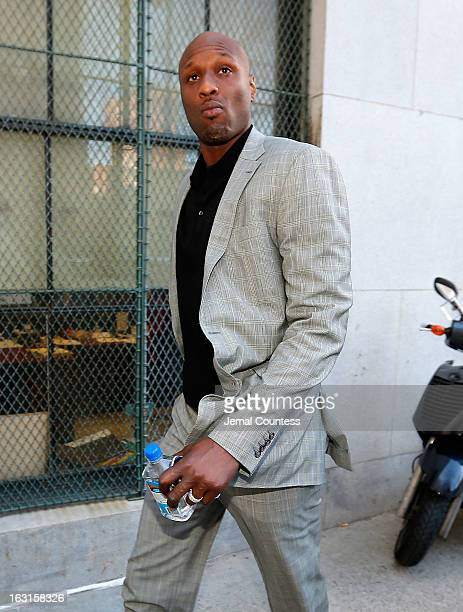 NBA player Lamar Odom arrives to attend a custody hearing with exgirlfriend Liza Morales at New York State Supreme Court on March 5 2013 in New York...