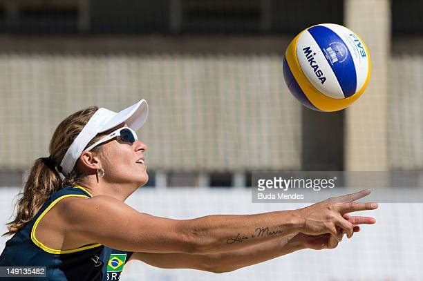Player Larissa Frana returns the ball during a beach volleyball training session at the Brazil Olympic team's camp in Crystal Palace on July 23,...