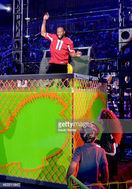 NFL player Larry Fitzgerald gets dunked onstage during Nickelodeon Kids' Choice Sports Awards 2014 at UCLA's Pauley Pavilion on July 17 2014 in Los...