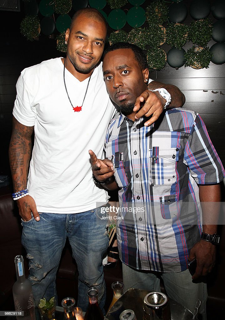 Player Larry Johnson and Publicist Denrick Romain attend The Official After Party For Earth Day New York at Greenhouse on April 22, 2010 in New York City.
