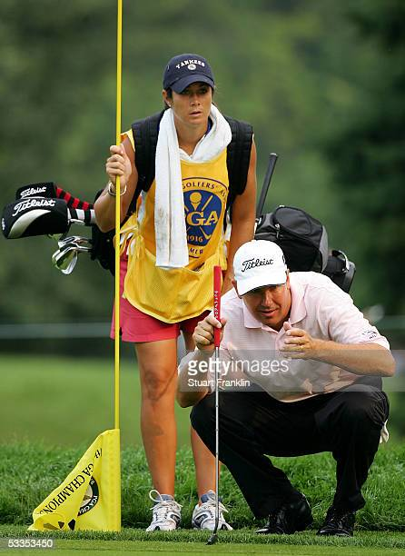 Player Laura Diaz lines up a putt with her brother Ron Philo Jr. During the first round of the 2005 PGA Championship at Baltusrol Golf Club on August...