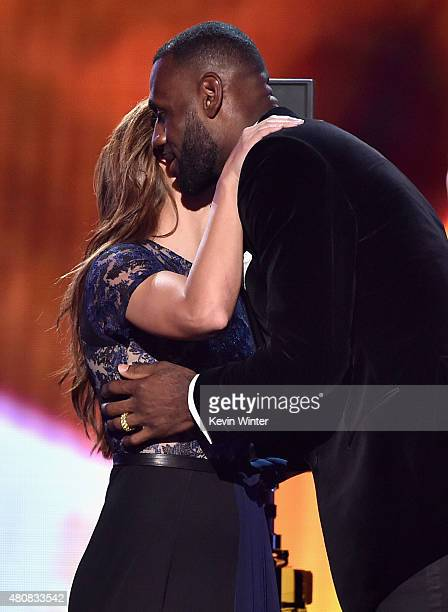 NBA player LeBron James accepts the award for Best Championship Performance from professional soccer player Alex Morgan onstage during The 2015 ESPYS...