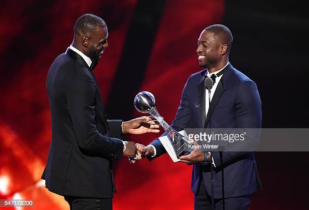 NBA player LeBron James accepts the Best Male Athlete award from NBA player Dwyane Wade onstage during the 2016 ESPYS at Microsoft Theater on July 13...