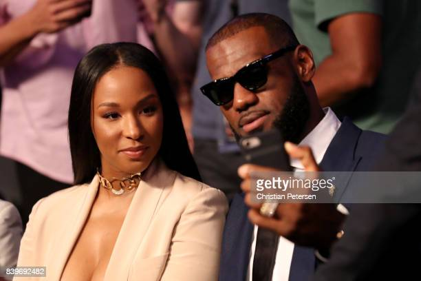 NBA player Lebron James and wife Savannah Brinson attends the super welterweight boxing match between Floyd Mayweather Jr and Conor McGregor on...