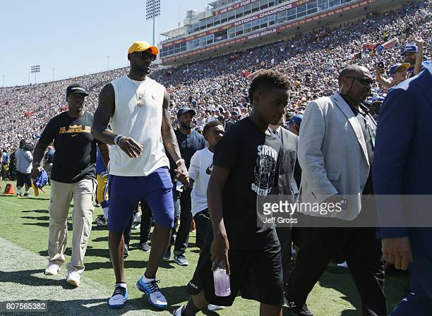 NBA player LeBron James of the Cleveland Cavaliers walks on the field during the home opening NFL game between the Los Angeles Rams and the Seattle...