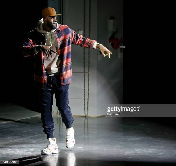 NBA player LeBron James walks the runway during the Kith Sport fashion show at the Classic Car Club on September 7 2017 in New York City
