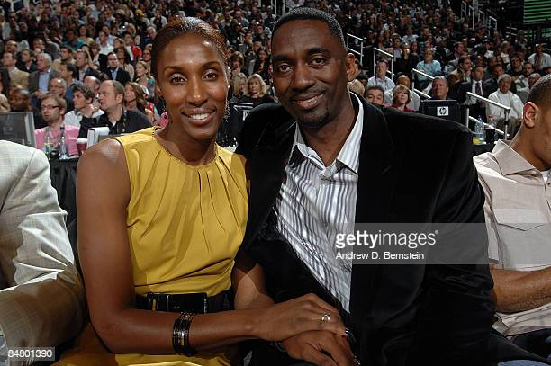 WNBA player Lisa Leslie and husband Michael Lockwood watch the Sprite Slam Dunk Contest on AllStar Saturday Night part of 2009 NBA AllStar Weekend at...