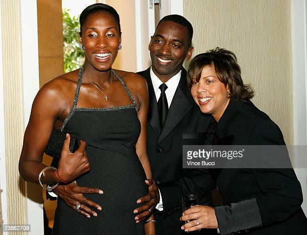 WNBA player Lisa Leslie husband Michael Lockwood and television personality Cheryl Miller pose for a photo at the VIP reception for The Billies...