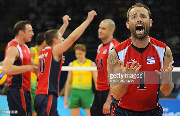 US player Lloy Ball celebrates a point against Brazil during the men's volleyball gold medal match in the 2008 Beijing Olympic Games in Beijing on...
