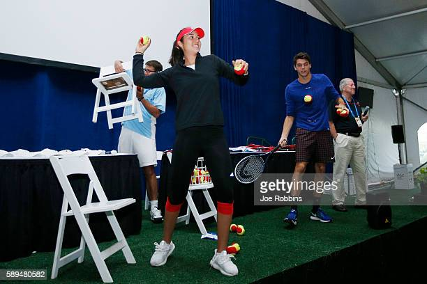 Player Louisa Chirico and ATP player Taylor Fritz hit autographed tennis balls to young fans during a High School Day event on Day 2 of the Western &...