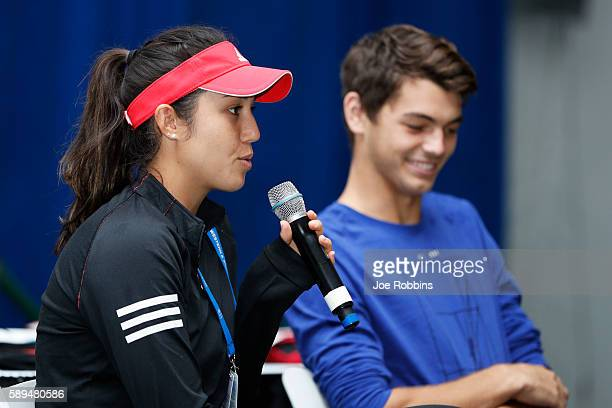 Player Louisa Chirico and ATP player Taylor Fritz speak to young fans during a High School Day event on Day 2 of the Western & Southern Open on...