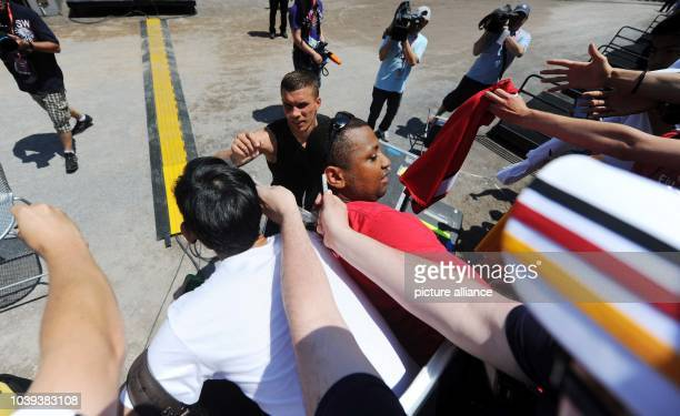 Player Lukas Podolski signs autographs after the final training of German national soccer team in Robert F Kennedy Memorial Staion in Washingtonm USA...