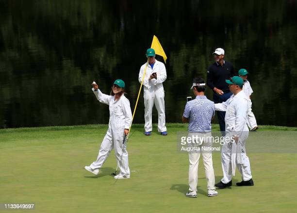 Player Lydia Ko caddies for Kevin Na during the Par 3 Contest at Augusta National Golf Club on Wednesday April 6, 2016.
