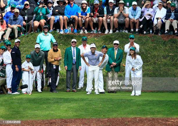 Player Lydia Ko drives on the No. 9 while caddying for Kevin Na during the Par 3 Contest at Augusta National Golf Club on Wednesday April 6, 2016.
