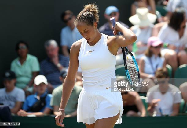 US player Madison Keys reacts against Russia's Evgeniya Rodina during their women's singles third round match on the fifth day of the 2018 Wimbledon...