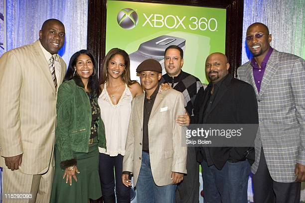 NBA player Magic Johnson and his wife Cookie Johnson Tracy Mourning Trey Mourning Keith Solomon Microsoft Executive Corey Rosemond Xbox Spokesperson...
