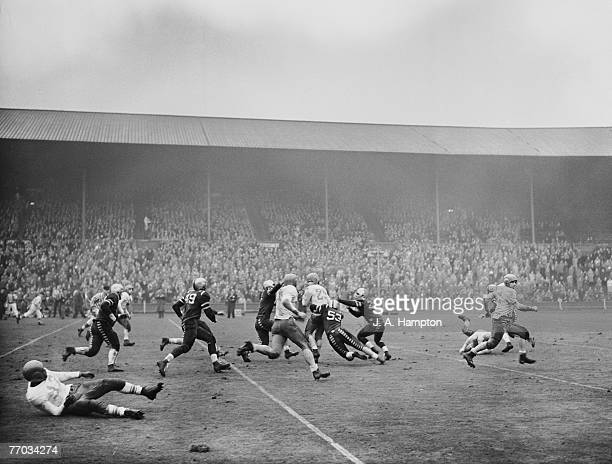 A player makes a tackle during the American Air Forces in Europe Football Championship final between the Burtonwood Bullets and Fuerstenfeldbruck...