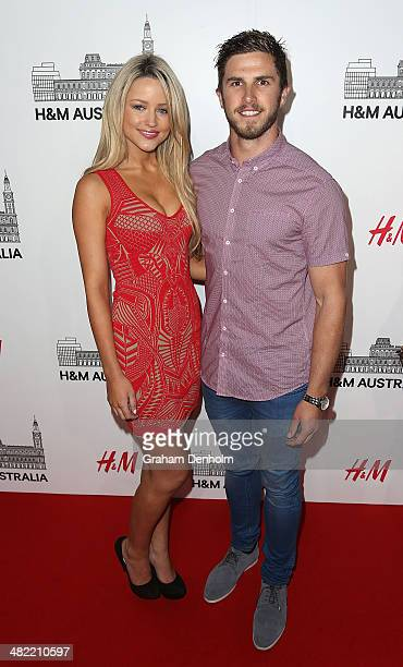 AFL player Marc Murphy and partner Jessie Habermann attend the VIP launch party for HM Australia at the GPO on April 3 2014 in Melbourne Australia