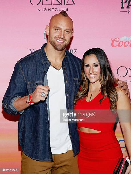 NFL player Mark Herzlich and Danielle Conti attend ESPN the Party at WestWorld of Scottsdale on January 30 2015 in Scottsdale Arizona