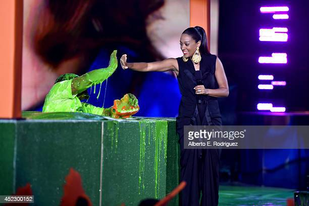 NFL player Marshawn Lynch and actress Tia MowryHardrict speak onstage during Nickelodeon Kids' Choice Sports Awards 2014 at UCLA's Pauley Pavilion on...