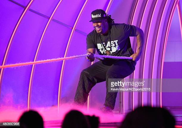 NFL player Marshawn Lynch plays tugofwar onstage at the Nickelodeon Kids' Choice Sports Awards 2015 at UCLA's Pauley Pavilion on July 16 2015 in...