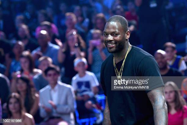 NFL player Martellus Bennett speaks onstage during the Nickelodeon Kids' Choice Sports 2018 at Barker Hangar on July 19 2018 in Santa Monica...