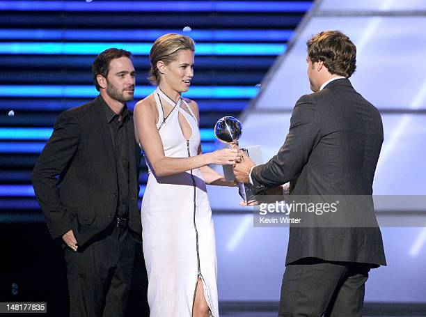 NFL player Matthew Stafford of the Detroit Lions accepts the Best Comeback award from Nascar driver Jimmie Johnson and actress Cody Horn onstage...