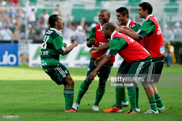 Player Max Santos of Palmeiras celebrates a scored goal against Ponte Preta during a match as part of Sao Paulo State Championship 2011 at Moises...
