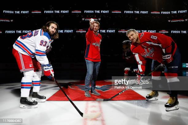 MLB player Max Scherzer of the Washington Nationals takes part in a ceremonial puck drop with Mika Zibanejad of the New York Rangers and Alex...