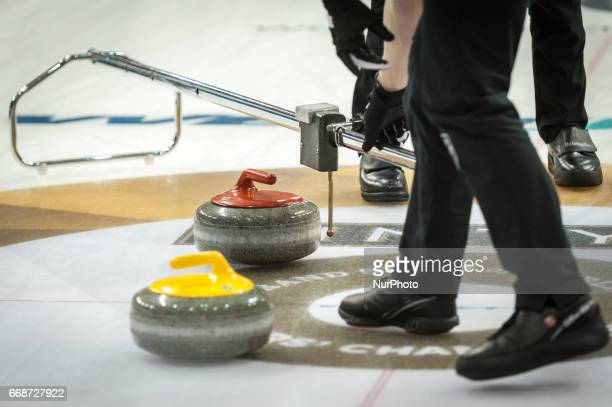Player measuring the distance between the stones during 2017 WetJet Players Championship which takes place in Ryerson's Mattamy Athletic Centre in...