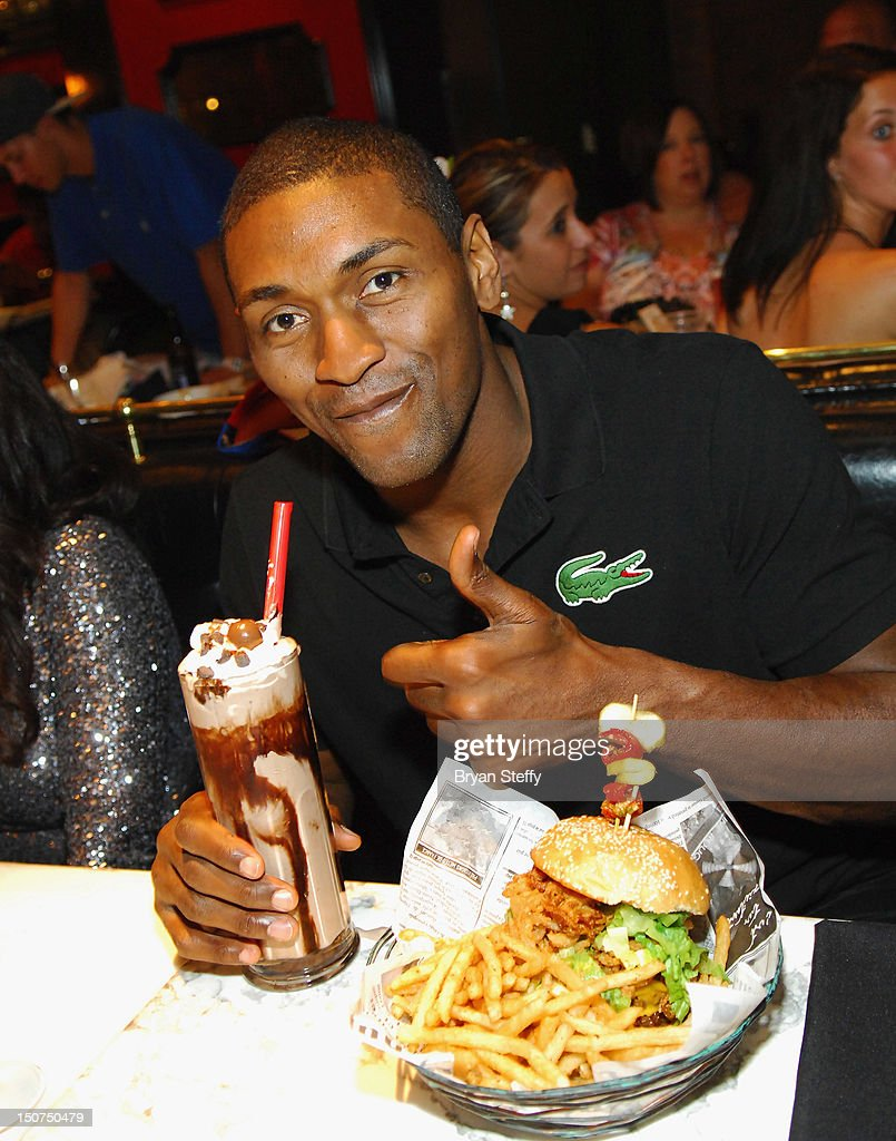 NBA player Metta World Peace dines at the Sugar Factory American Brasserie at the Paris Las Vegas on August 25, 2012 in Las Vegas, Nevada.