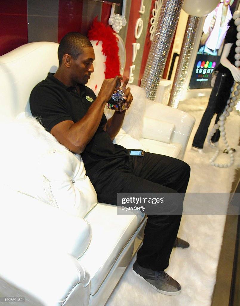 NBA player Metta World Peace shops at the Sugar Factory American Brasserie at the Paris Las Vegas on August 25, 2012 in Las Vegas, Nevada.