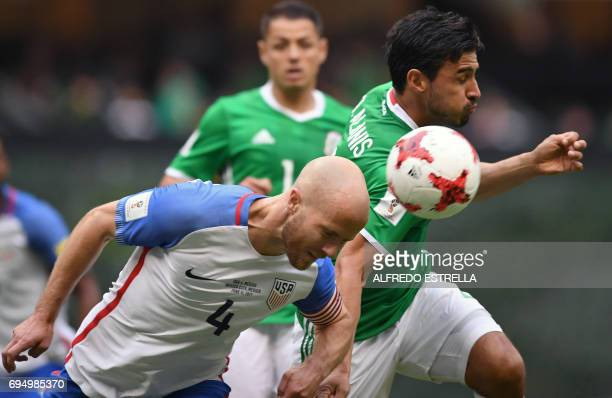US' player Michael Bradley vies with Mexico's Oswaldo Alanis during their 2018 FIFA World Cup Concacaf qualifier football match in Mexico City on...