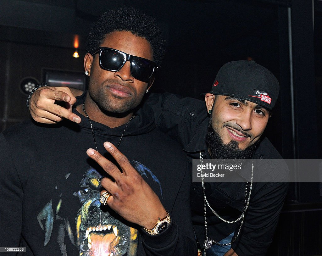 NFL player Michael Crabtree of the San Francisco 49ers (L) and pitcher Sergio Romo of the San Francisco Giants appear at Haze Nightclub at the Aria Resort & Casino at CityCenter on December 30, 2012 in Las Vegas, Nevada.